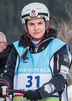 Musher de La Grande Odyssée Savoie Mont Blanc, la course de chiens de traineaux.
